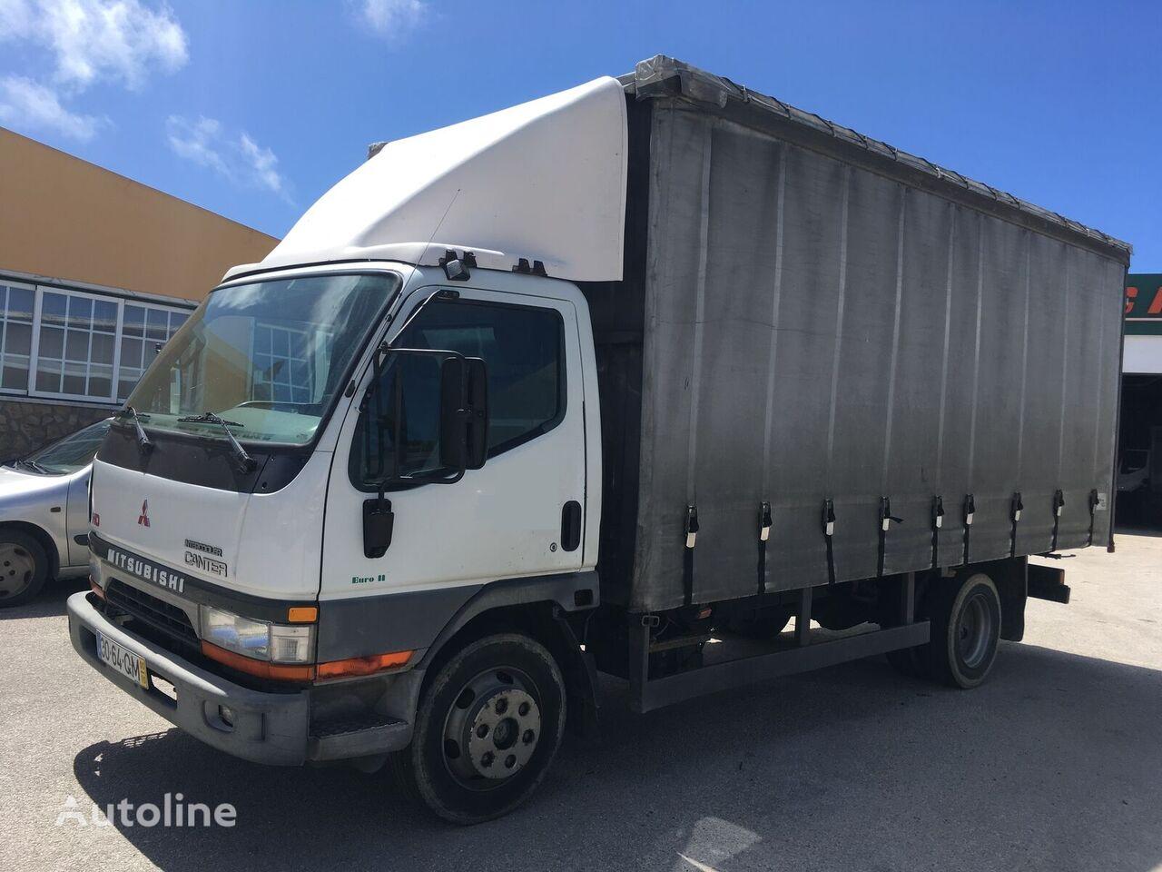camion centinato MITSUBISHI CANTER HD